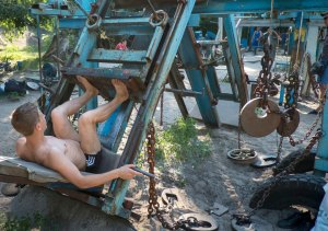 A man trains at the Kachalka outdoor gym on the banks of river Dniper in Kiev