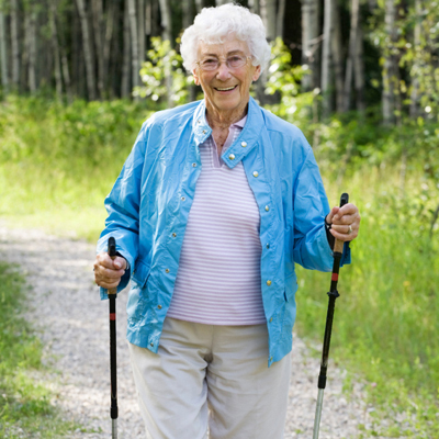 elderly-woman-walking-woods-400x400